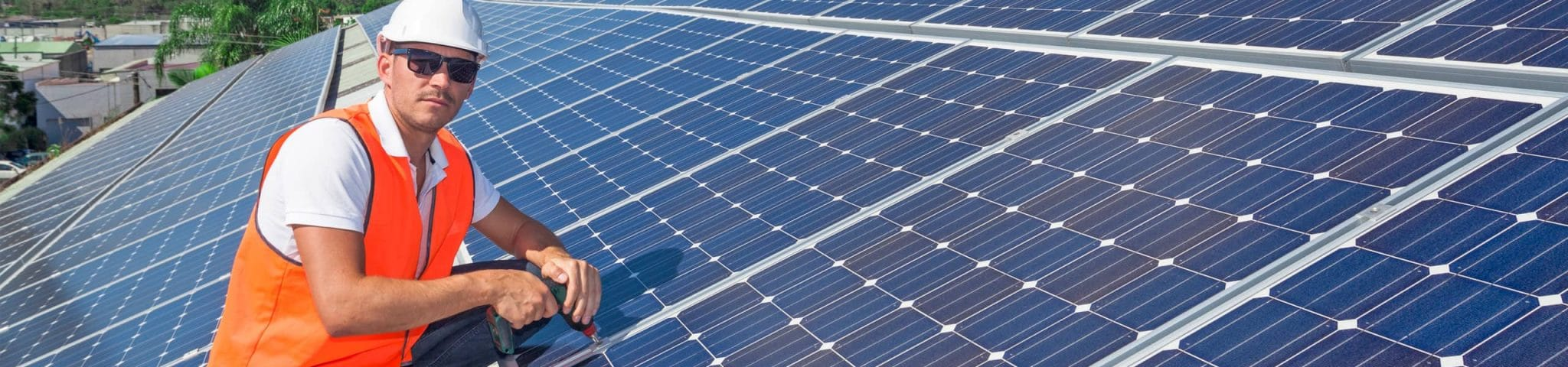 Photo of man fixing solar panel