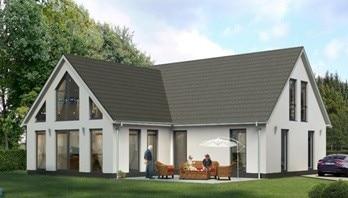 Ett stort vitt hus som kan ha solceller på taket